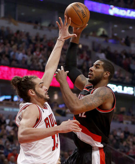 Portland's LaMarcus Aldridge shoots over Chicago's Joakim Noah. The Texas-ex had just five points but grabbed 13 rebounds in the Blazers' victory. Photo: Charles Rex Arbogast / Associated Press / AP