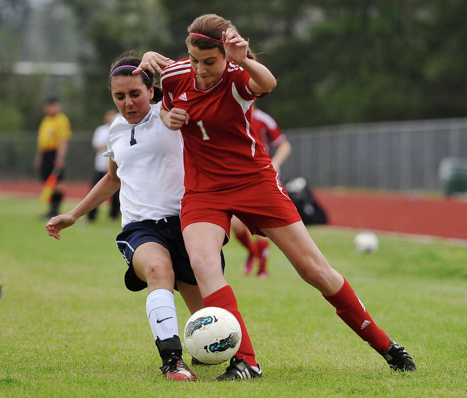 Tomball's Jessica Evans, No. 1, and Lumberton's Kennedy Hardy, No. 1, collide as they fight for control of the ball during Friday's match. The Lumberton High School girls soccer team played against Tomball at Kingwood Park High School in Humble, TX, on Friday afternoon. Photo taken Friday, 3/28/14 Jake Daniels/@JakeD_in_SETX Photo: Jake Daniels / ©2014 The Beaumont Enterprise/Jake Daniels