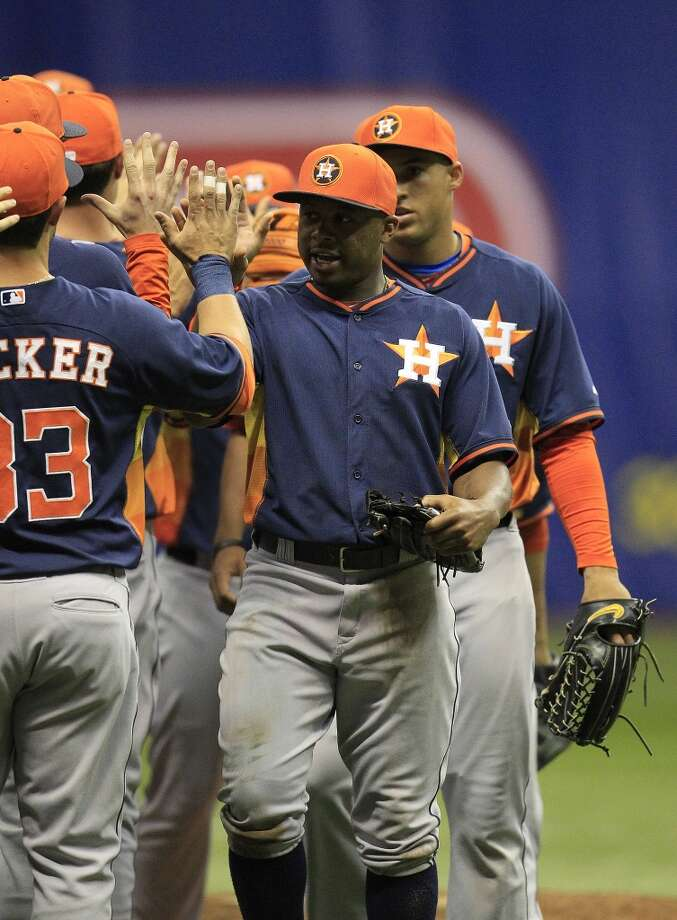 Adron Chambers celebrates the Astros win over the Rangers with teammates. Photo: Karen Warren, Houston Chronicle