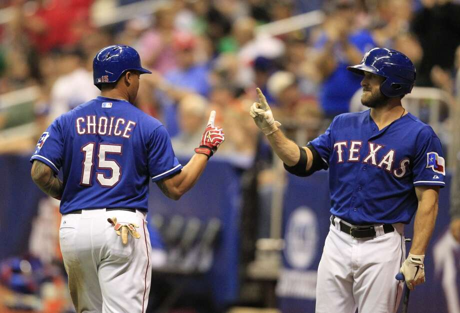 Michael Choice celebrates his home run with Bryan Petersen. Photo: Karen Warren, Houston Chronicle