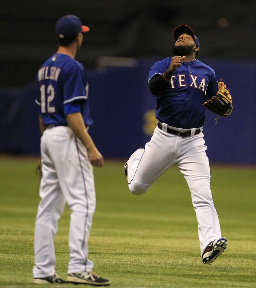 Elvis Andrus looks up for a ball hit for a single by Jonathan Villar. Photo: Karen Warren, Houston Chronicle