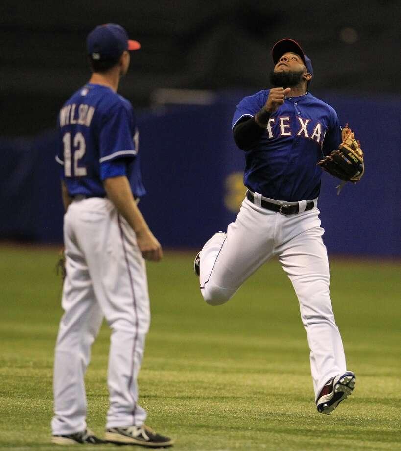 Elvis Andrus looks up for a ball hit for a single by Jonathan Villar. Photo: Karen Warren, Houston Chronicle