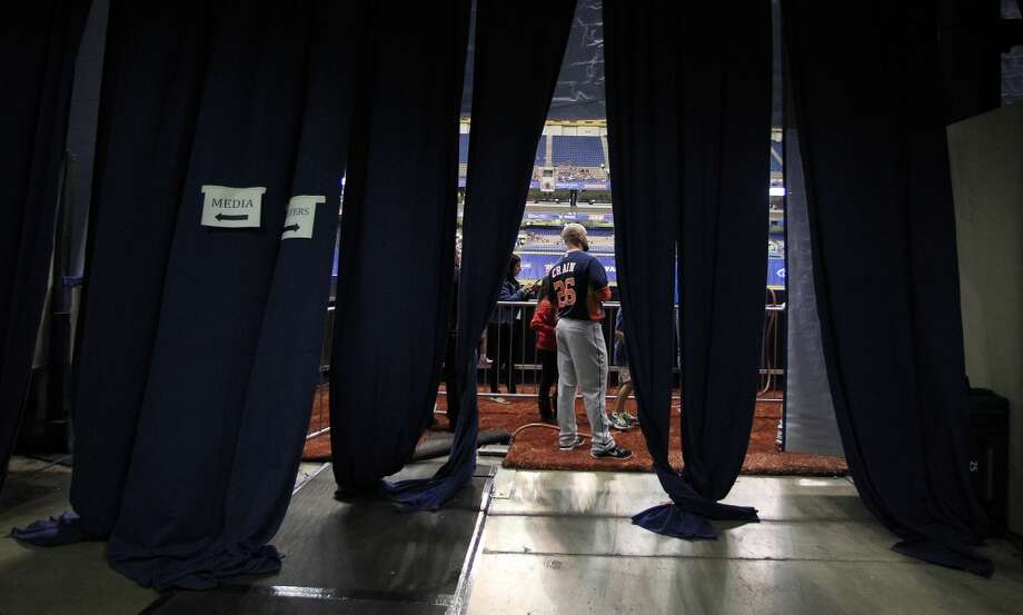 Astros RHP Jesse Crain stands just inside the field before the start of the game. Photo: Karen Warren, Houston Chronicle