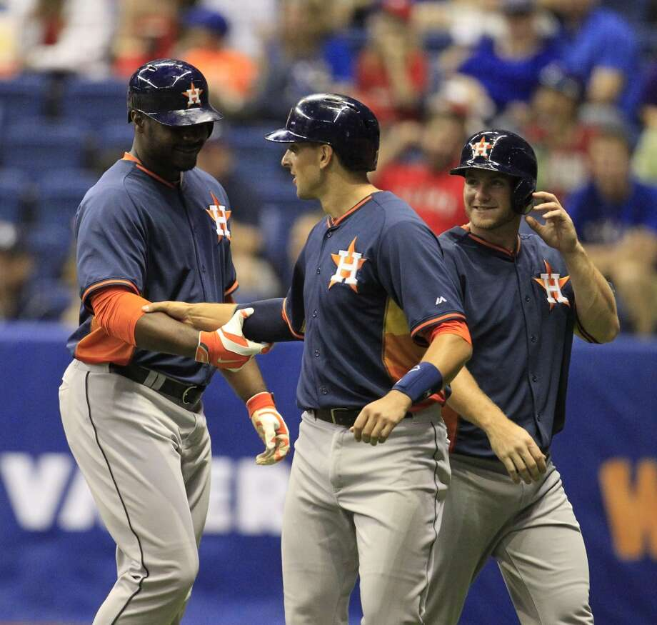 Chris Carter is congratulated by catcher Jason Castro after he hit a three-run home run. Photo: Karen Warren, Houston Chronicle