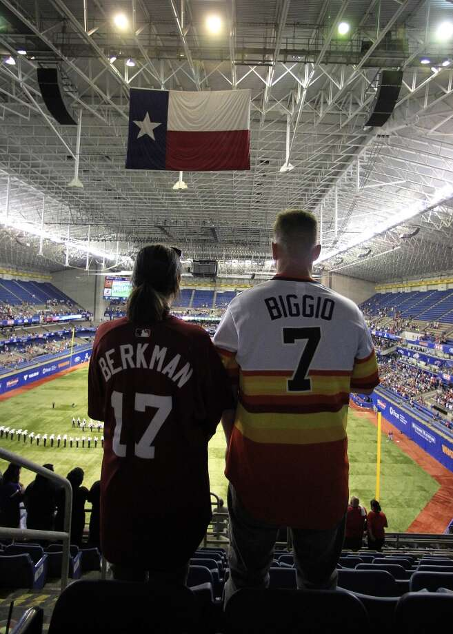 Michael Taleki and his girlfriend Alyssia Munoz wear Astros jerseys as the watch pre-game ceremonies. Photo: Karen Warren, Houston Chronicle