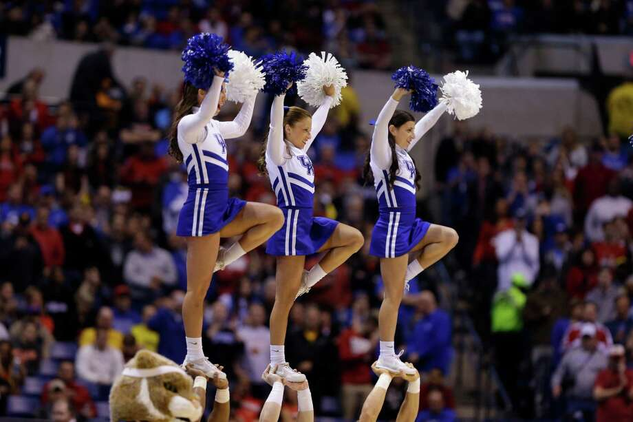 Kentucky cheerleaders perform during the first half of an NCAA Midwest Regional semifinal college basketball tournament game against the Louisville Friday, March 28, 2014, in Indianapolis. (AP Photo/David J. Phillip) Photo: David J. Phillip, Associated Press / AP