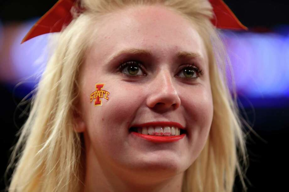 NEW YORK, NY - MARCH 28:  A cheerleader from the Iowa State Cyclones look on during the regional semifinal of the 2014 NCAA Men's Basketball Tournament at Madison Square Garden on March 28, 2014 in New York City. Photo: Bruce Bennett, Getty Images / 2014 Getty Images