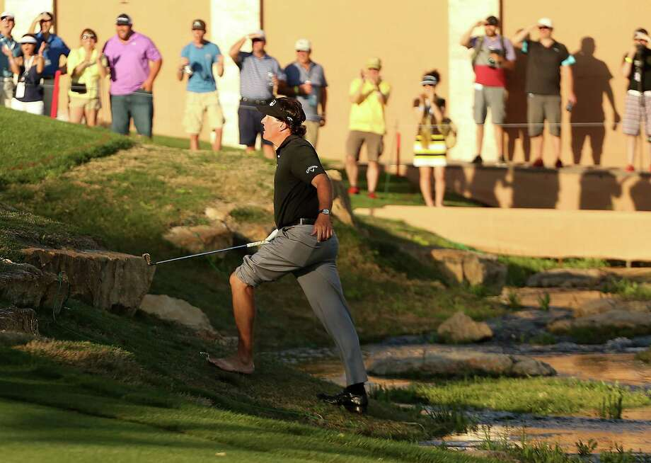 Phil Mickelson was up the creek on No. 18 at the Texas Open but survived to make the cut Friday. Photo: Darren Carroll, Stringer / 2014 Getty Images