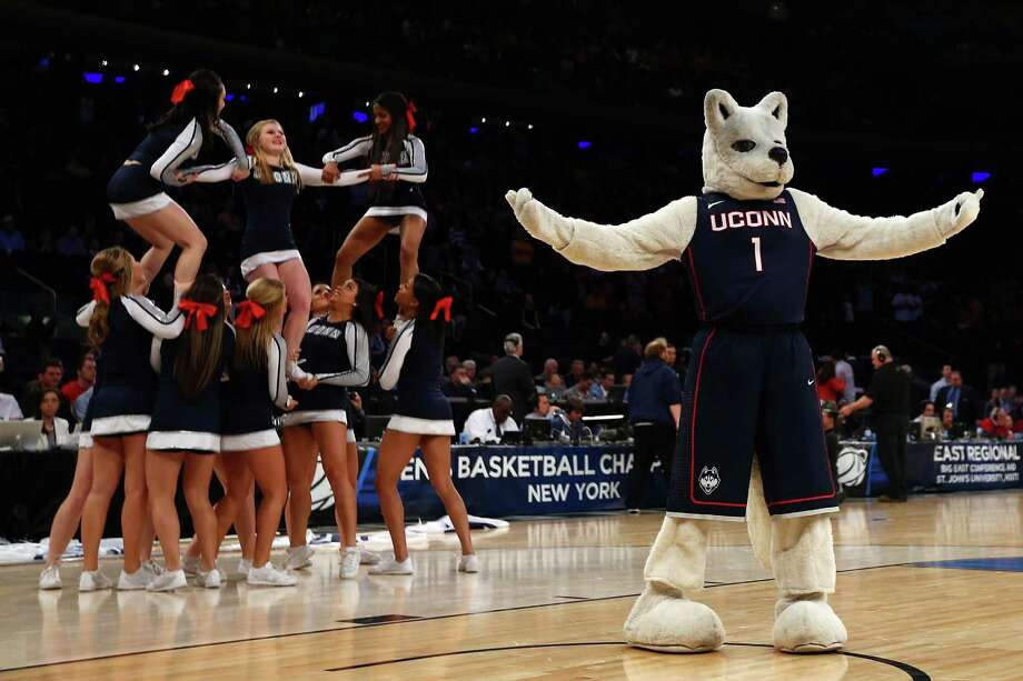 NEW YORK, NY - MARCH 28:  The Connecticut Huskies cheerleaders and mascot perform during the regional semifinal of the 2014 NCAA Men's Basketball Tournament at Madison Square Garden on March 28, 2014 in New York City. Photo: Elsa, Getty Images / 2014 Getty Images