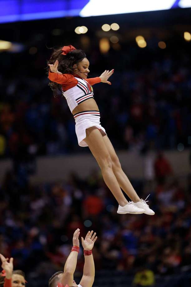 Louisville cheerleaders perform during the first half of an NCAA Midwest Regional semifinal college basketball tournament game against the Kentucky Friday, March 28, 2014, in Indianapolis. (AP Photo/David J. Phillip) Photo: David J. Phillip, Associated Press / AP