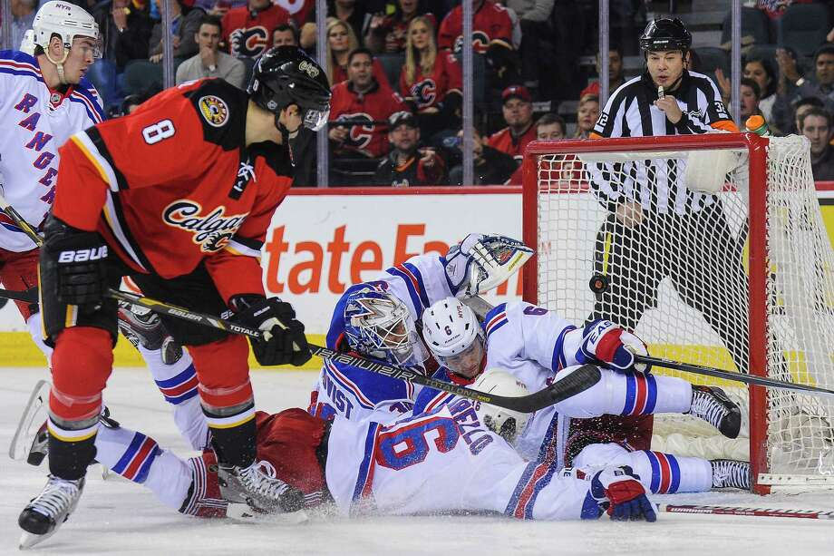 CALGARY, AB - MARCH 28: Joe Colborne #8 of the Calgary Flames scores against Henrik Lundqvist #30 of the New York Rangers during an NHL game at Scotiabank Saddledome on March 28, 2014 in Calgary, Alberta, Canada. (Photo by Derek Leung/Getty Images) ORG XMIT: 181115545 Photo: Derek Leung / 2014 Getty Images