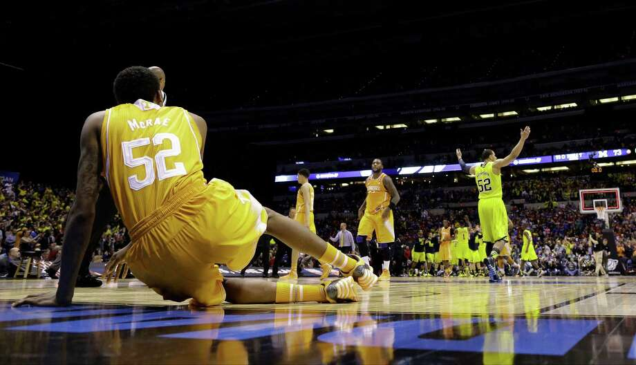 Tennessee's Jordan McRae couldn't stand the sight of Michigan players walking away with a win after the Volunteers almost pulled off an incredible comeback. Photo: David J. Phillip, STF / AP