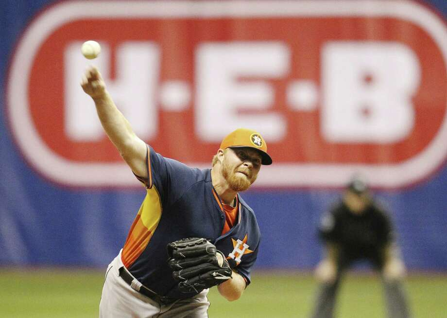Astros pitcher Jason Stoffel pitched the ninth inning and earned the save Friday in the Alamodome. Photo: Kin Man Hui / San Antonio Express-News / ©2014 San Antonio Express-News