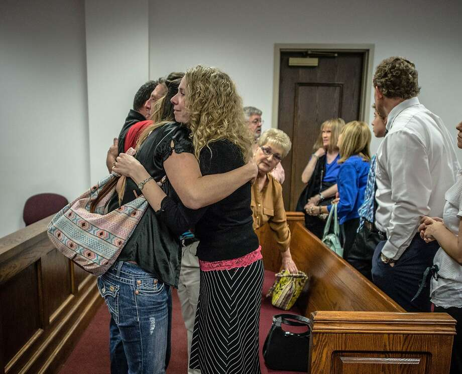 Jennifer Campbell, the mother of  Mason Campbell,  is hugged by a friend after a competency hearing for her son ends Friday March 28, 2014, in Roswell, N.M.  It was declared that Mason Campbell is competent to stand trial later this year.  (AP Photo/Albuquerque Journal, Roberto E. Rosales) Photo: Roberto E. Rosales, Associated Press