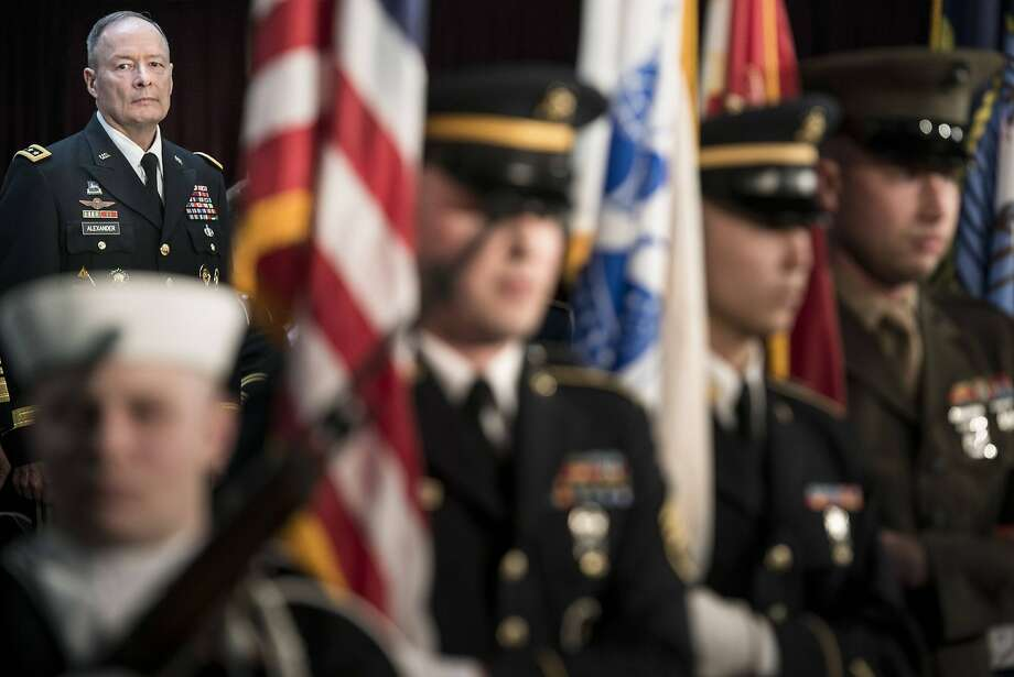 General Keith B. Alexander watches the color guard during his retirement ceremony at the National Security Agency in Fort Meade, Maryland March 28, 2014.  REUTERS/Brendan Smialowski/Pool (UNITED STATES - Tags: MILITARY) Photo: Pool, Reuters