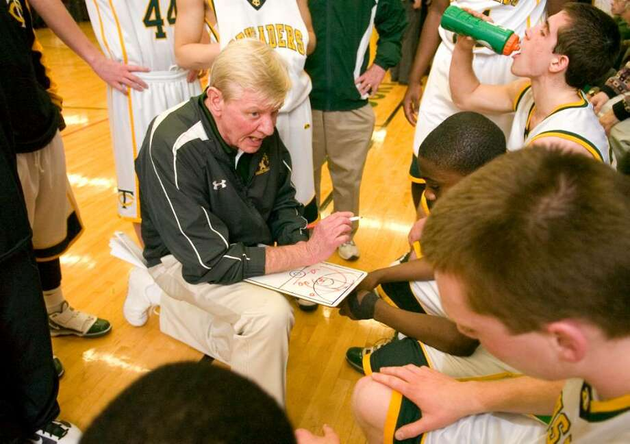 Trinity head coach Mike Walsh talks to his team during a time out during an FCIAC boys basketball game against Stamford High School at Trinity Catholic High School in Stamford, Conn. on Tuesday, Feb. 9, 2010. Photo: Chris Preovolos / Stamford Advocate