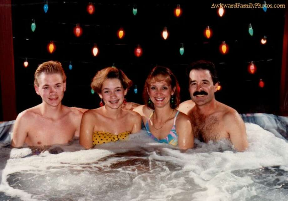 This family prefers the wet 70s look. Photo: Awkward Family Photos