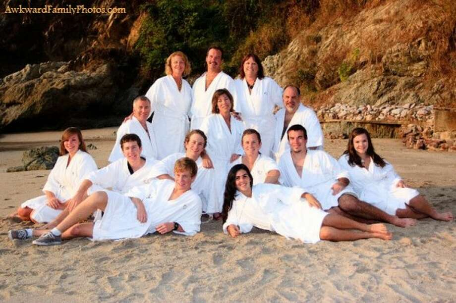 A family that wears bathrobes together stays together. Photo: Awkward Family Photos
