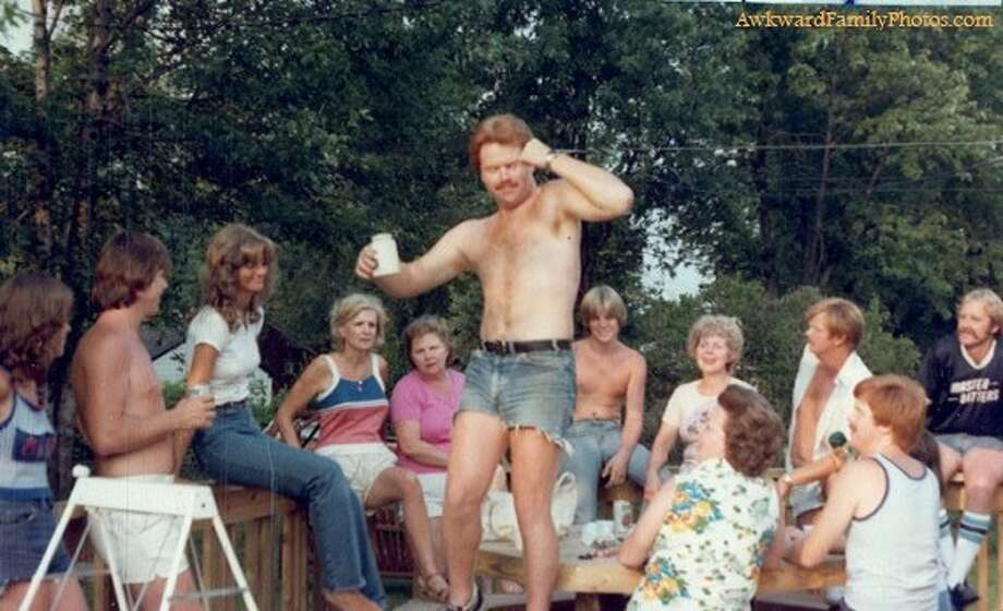 In this small town, only one man dared to defy the ban on dancing and jorts. Photo: Awkward Family Photos