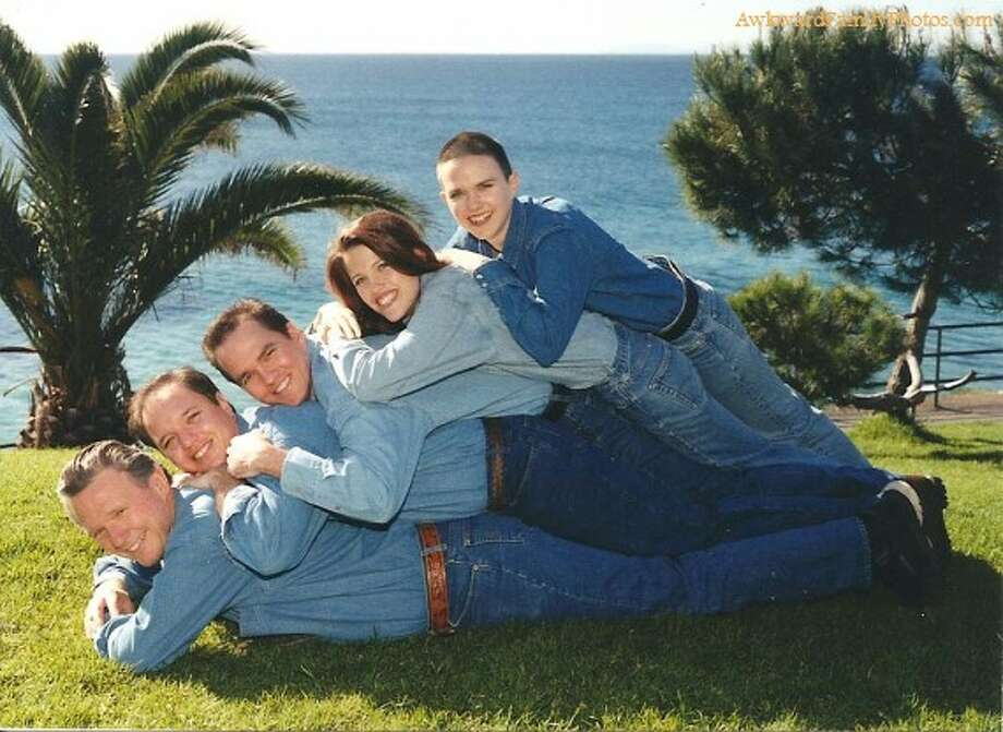 They wanted their pose and clothes to mimic an ocean wave. Photo: Awkward Family Photos