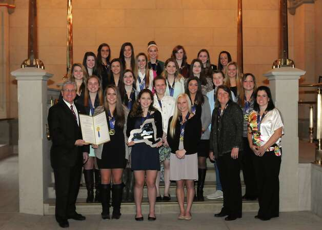 Assemblyman Jim Tedisco, R-Glenville, presents a resolution he sponsored that passed the Legislature unanimously, honoring the New York State Public High School Athletic Association Class A State Champion Shenendehowa Field Hockey Team. The Shenendehowa Field Hockey Team became only the second Class A state champion from Section II since 1987 after defeating two-time defending state champion Sachem East by a score of 3-2 in triple overtime.  Shen scored a school record of 81 goals on the season along with 60 assists.  Shen had a season record of 20 wins and 2 losses. Tedisco introduced the team and each student athlete and coach on the Floor of the state Assembly Chamber in Albany March 20 and be recognized for their outstanding athletic accomplishments. (Adam Kramer) / Robert Ragaini