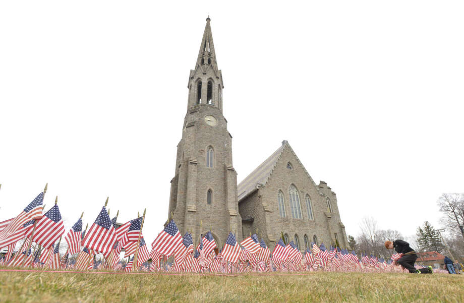 "The ""Field of Flags,"" installation at the Second Congregational Church in Greenwich, Saturday morning, March 29, 2014. According to Rev. Maxwell Grant, senior minister of Second Congregational Church,  ""Field of Flags,"" is a temporary outdoor installation of more than 7,000 American flags placed in honor of American military personnel who lost their lives while serving in Iraq or Afghanistan. Rev. Grant said that a brief dedication ceremony will be held Sunday, March 30, at 11:15 a.m., following the churchâÄôs regular Sunday worship service. Rev. Grant also said the traveling installation was started in October 2005 by the Somers Congregational Church in Somers, Conn., and has traveled to churches throughout Connecticut, as well as in Virginia, Florida, New Jersey, Pennsylvania and Tennessee. The first installation featured 2,231 flags. Photo: Bob Luckey / Greenwich Time"