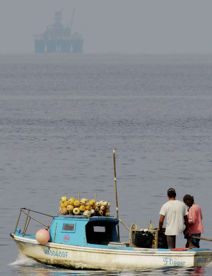 An exploratory drilling rig sits in the waters off Cuba's northern coast as fishermen work in Havana Bay, Cuba.  An exploratory drilling rig sits in the waters off Cuba's northern coast as fishermen work in Havana Bay, Cuba. Photo: Javier Galeano, STF / AP