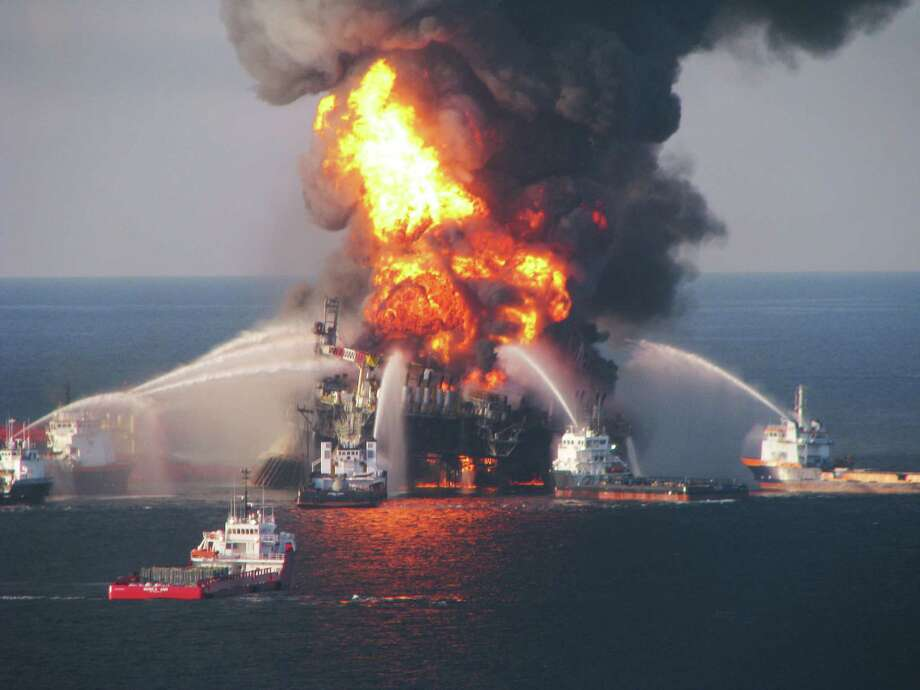 Fire boats battle a fire at the off shore oil rig Deepwater Horizon April 21, 2010 in the Gulf of Mexico off the coast of Louisiana. Multiple Coast Guard helicopters, planes and cutters responded to rescue the Deepwater Horizons 126 person crew after an explosion and fire caused the crew to evacuate.  (Photo by U.S. Coast Guard via Getty Images)  for Lise Olsen story on Oil Patch Deaths -- Day 1 Photo: U.S. Coast Guard, Handout / 2010 U.S. Coast Guard
