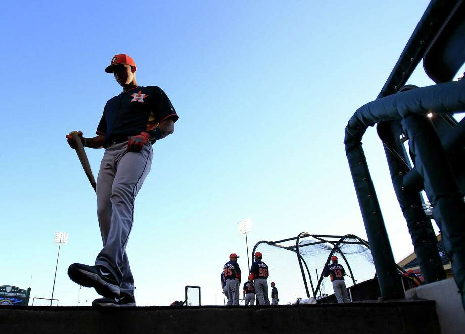 Carlos Correa, who will start in Class A, has set a goal of being back in the Astros' dugout by September when rosters expand. Photo: Karen Warren, Staff / © 2013 Houston Chronicle