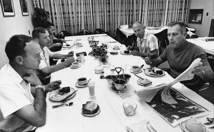 Apollo astronauts listen to Deke Slayton, director of flight crew operations for historic Apollo 11 flight, right, as they have their pre-flight breakfast at Cape Kennedy, Florida, on July 16, 1969. From left, they are Command Module pilot Michael Collins, Command Pilot Neil A. Armstrong, William A. Anders, and Edwin E. Aldrin Jr. Anders is a member of the Apollo 11 backup crew.