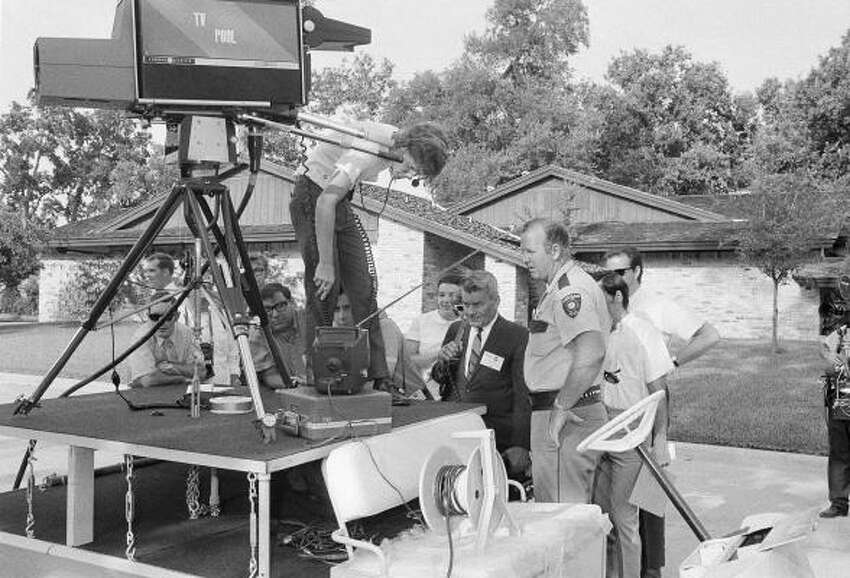 Newsmen and neighbors gather in front of a mobile television unit at the home of Astronaut Michael Collins, near the Manned Spacecraft Center, July 16, 1969, Houston, Texas. They were gathered to watch the blastoff of the Saturn rocket carrying the Apollo 11 spacecraft on its way to the moon.