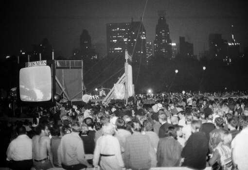 In this July 20, 1969 file photo,  a crowd watches, as the Apollo 11 crew lands on the moon, in Central Park, New York. Photo: Marty Lederhandler, AP