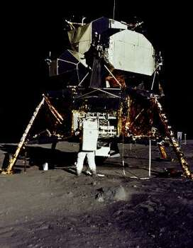 "This July 20, 1969 file photo released by NASA shows Apollo 11 astronaut Edwin E. ""Buzz"" Aldrin, Jr. removing a scientific experiment from the Lunar Module ""Eagle"" during the Apollo 11 lunar landing mission. As an estimated 500 million people around the world waited with bated breath crowded around fuzzy television screens and radios, Armstrong stepped down the lunar module's ladder and onto the lunar surface. ""That's one small step for man, one giant leap for mankind,"" Armstrong intoned, his words slightly distorted by distance and communications equipment, in a phrase now etched forever into the history books. Photo: -, AFP/Getty Images"