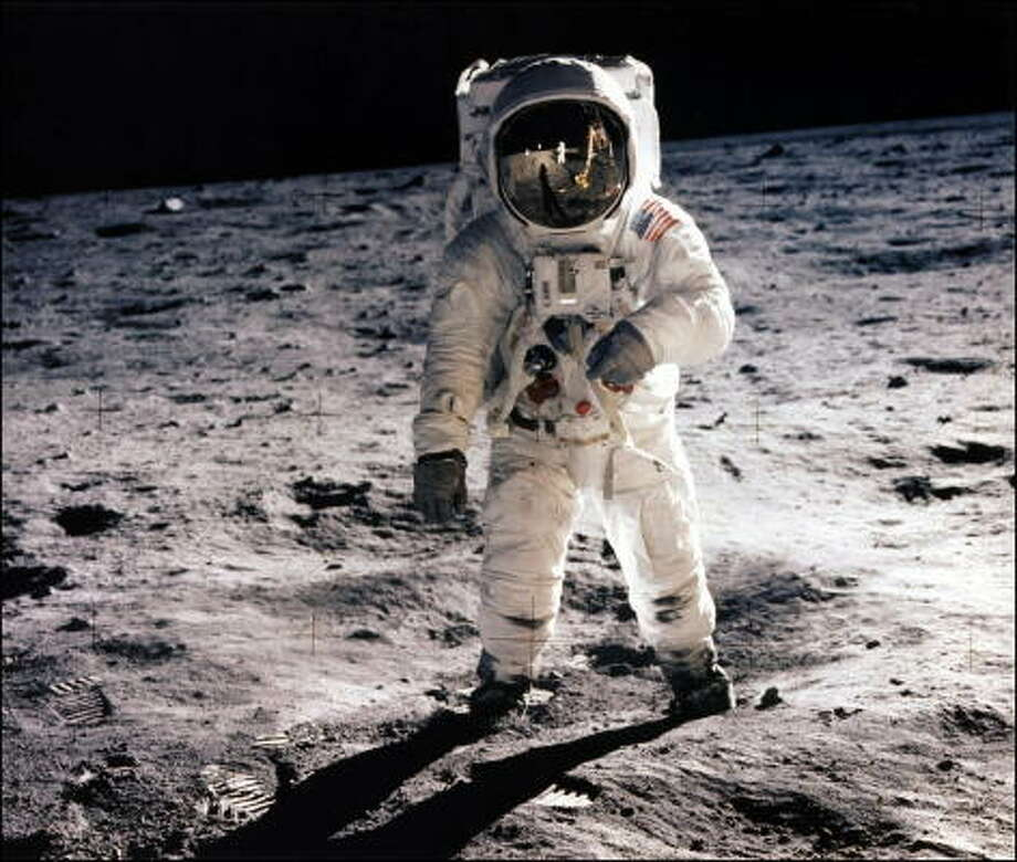 Edwin E. Aldrin Jr., lunar module pilot, walking on the surface of the moon during the Apollo 11 extravehicular activity (EVA). Astronaut Neil A. Armstrong took this photograph with a 70mm lunar surface camera. With one small step off a ladder, commander of the Apollo 11 mission Neil Armstrong of the US became the first human to set foot on the moon on July 20, 1969, before the eyes of hundreds of millions of awed television viewers worldwide. With that step, he placed mankind's first footprint on an extraterrestrial world and gained instant hero status. Photo: NASA, AFP/Getty Images