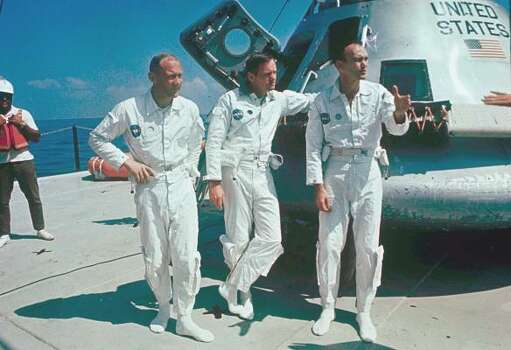 In this 1969 file photo,  Apollo 11 astronauts stand next to their spacecraft in 1969, from left to right:  Col. Edwin E. Aldrin, lunar module pilot; Neil Armstrong, flight commander; and Lt. Michael Collins, command module pilot. Photo: Anonymous, AP