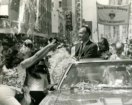 Michael Collins during a ticker tape parade in downtown Houston. Photo: JERRY CLICK, HOUSTON CHRONICLE