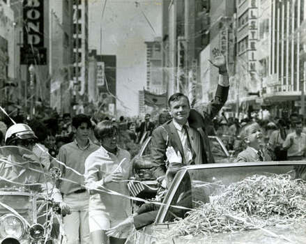 Neil Armstrong waves along with his wife and son from confetti-strewn car. Photo: JERRY CLICK, HOUSTON CHRONICLE
