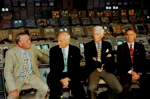 "Apollo astronauts, from left, Neil Armstrong, Edwin ""Buzz"" Aldrin, Gene Cernan, and Walter Cunningham hold a press conference in a replica of an Apollo control room at Kennedy Space Center, Fla. Friday July 16, 1999. The men were at the center to help celebrate the 30th anniversary of the Apollo 11 launch. Photo: TERRY RENNA, ASSOCIATED PRESS"