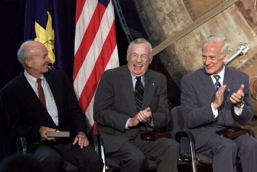 "Apollo 11 astronaut Neil Armstrong, center, with fellow astronauts Edwin A. ""Buzz"" Aldrin, right, and Michael Collins, left, laugh Tuesday, July 20, 1999 at a ceremony in the Smithsonian Air and Space Museum in Washington, were they were presented the Langley Gold Medal for aviation by Vice President Al Gore. The event marks the 30th anniversay of the first landing on the moon by the three crew members. Photo: DOUG MILLS, ASSOCIATED PRESS"