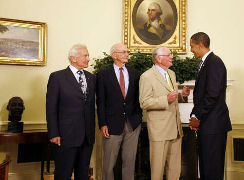 "U.S. President Barack Obama meets with Apollo 11 astronauts, from left, Edwin ""Buzz"" Aldrin, the second man to walk on the moon, Michael Collins, the command module pilot, and Neil Armstrong, who took the first step on the moon, in the Oval Office of the White House in Washington, D.C., U.S. Obama used the appearance with the astronauts to reinforce his call for greater emphasis on math and science in U.S. schools. Photo: MARTIN SIMON, VIA BLOOMBERG"