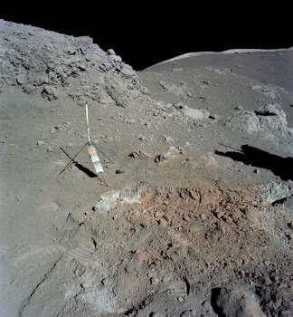 Harrison Schmitt discovers orange soil during a moon walk. Photo: NASA File