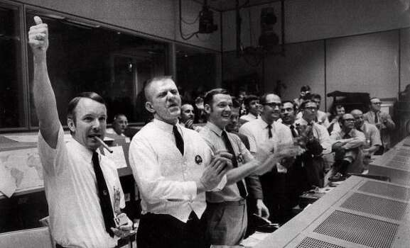 The Apollo 13 flight crew directors who brought the crippled spacecraft back to Earth celebrate in Mission Control at the Manned Spacecraft Center, Houston as they learn of the command module's successful splashdown April 17, 1970.  From left, are: Gerald Griffin, Eugene F. Kranz, Glynn S. Lunney and Milton L. Windler. Photo: AP