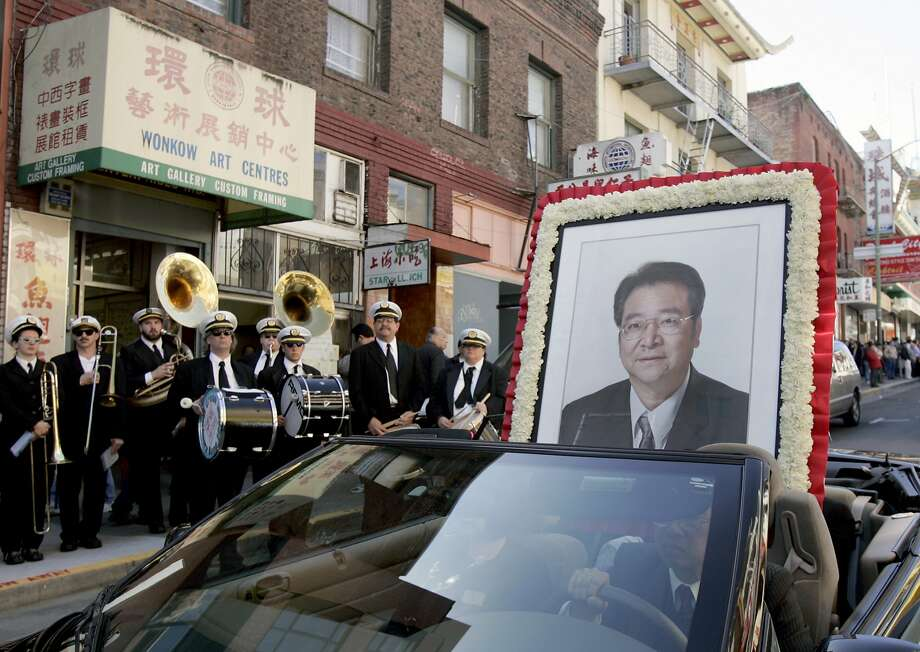 The lead car carrying a portrait of Allen Leung stops in front of Wonkow Art Centres on Jackson Street where Leung was shot to death. A funeral procession for Allen Leung makes its way through the streets of Chinatown in San Francisco, Calif. on 3/18/06. Leung was killed in his business on Jackson Street nearly two weeks ago. PAUL CHINN/The Chronicle Photo: Paul Chinn, SFC