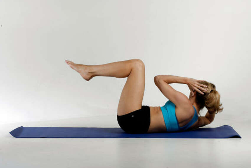 CRISS-CROSS: Lie on back with knees bent. Lift shoulders, and curl chin to chest. Straighten left leg to nose level, toes in line with nose, while right knee nears chest. Inhale as you twist torso so right elbow touches left knee. Repeat 5-10 times.
