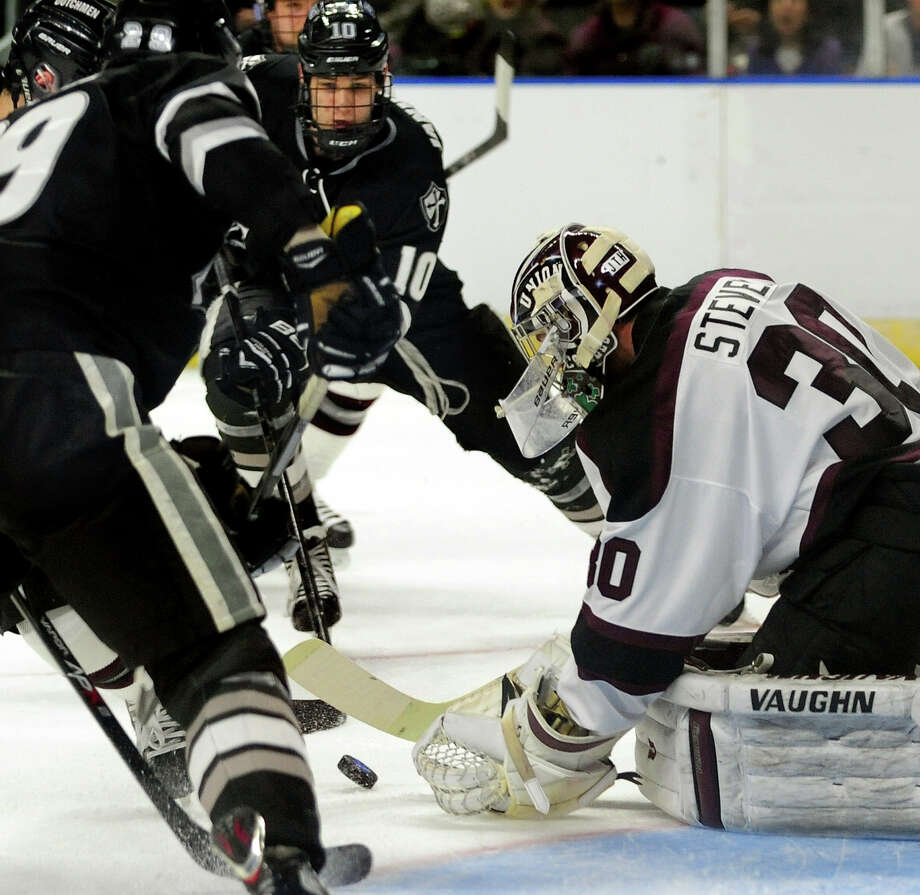 Union College goalie Colin Stevens goes to cover the puck while Providence's Mark Jankowski and Conor MacPhee converge, during the 2014 NCAA Men's Ice Hockey East Regional at the Webster Bank Arena in Bridgeport, Conn. on Saturday March 29, 2014. Photo: Christian Abraham / Connecticut Post