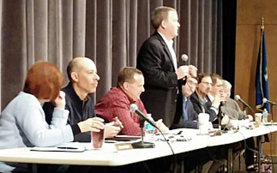 Board of Finance Chairman Thomas Flynn, with fellow board members, addresses the crowd at Saturday's forum on the proposed 2014-15 town budget at Roger Ludlowe Middle School. Photo: Andrew Brophy / Fairfield Citizen