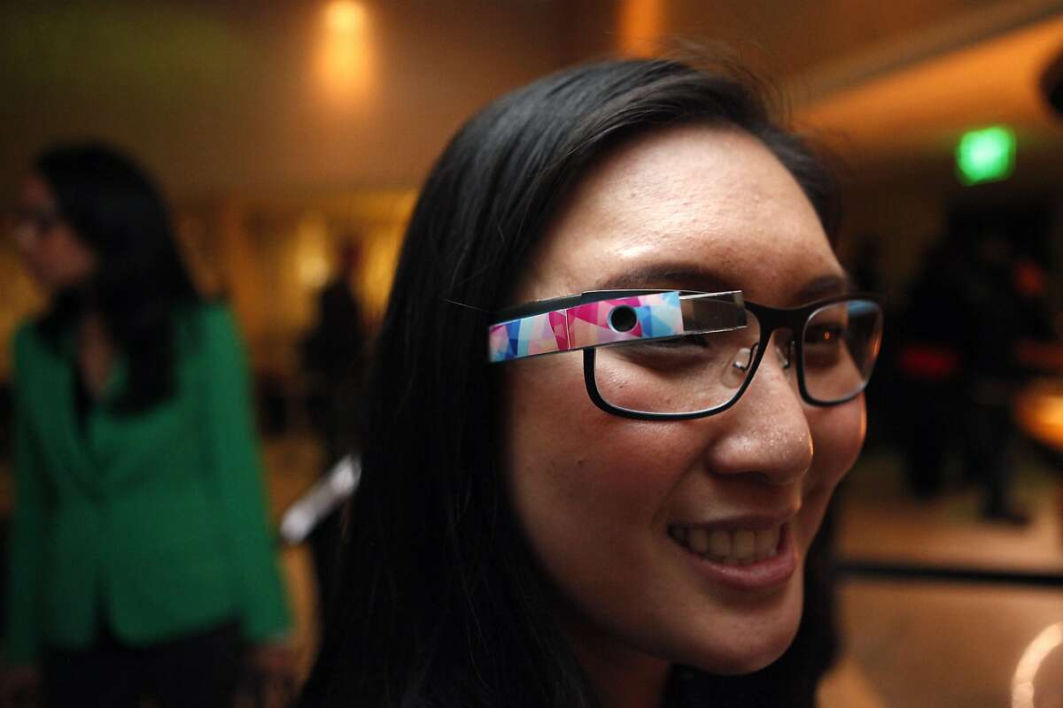 Libby Chang of Sunnyvale shows off her glasses with a decal from the company GPop on the side, during a Google Glass meet-up at the Stanford Court Hotel in San Francisco, CA, Friday March 28, 2014.