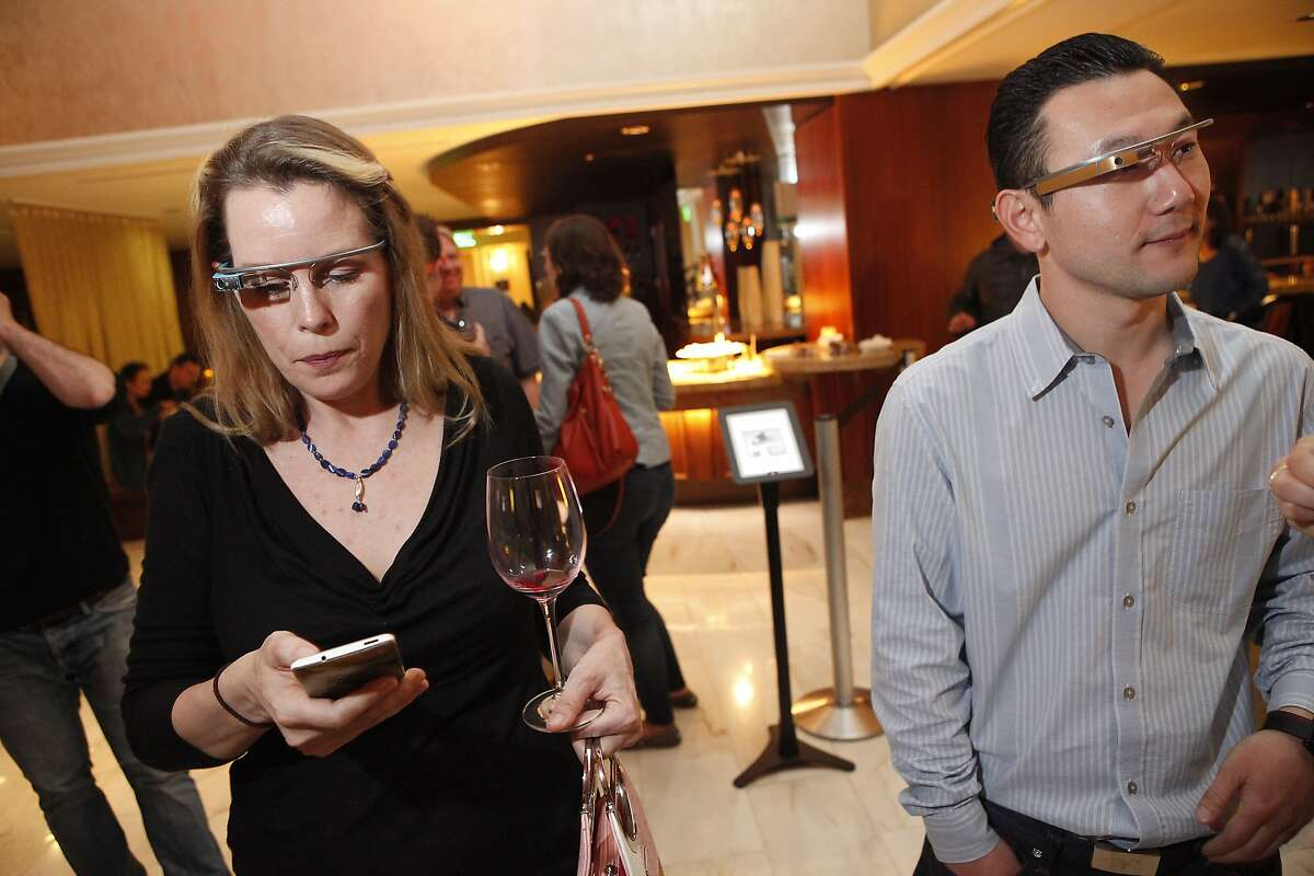 Liza Gere, left and Sean Im mingle during a Google Glass meet-up at the Stanford Court Hotel in San Francisco, CA, Friday March 28, 2014.