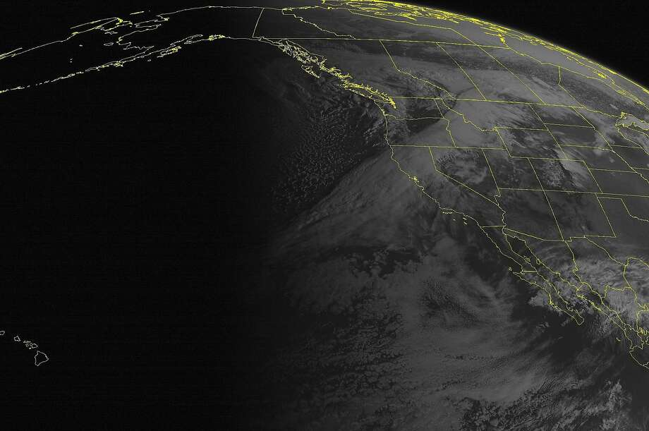 This NOAA satellite image taken Saturday, March 29, 2014, at 11:00 a.m. EDT shows a storm system approaching the Pacific Northwest, with a band of clouds accompanying its cold front into northern California and the northern Intermountain West. Much of the Southwest was under the influence of sunny high pressure. A series of disturbances off the coast will continue to bring unsettled weather to the West in the coming days. Some much-needed heavy rain will be likely across California, while some flooding could occur in the Pacific Northwest. (AP Photo/Weather Underground) Photo: Uncredited, Associated Press