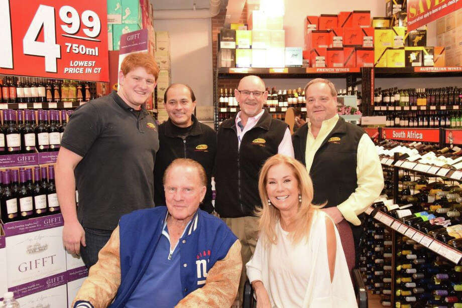 Frank and Kathie Lee Gifford pose with the staff of BevMax in Stamford on Friday. Kathie Lee Gifford was there to sign bottles of her new wine ìGifft.î Photo: Contributed Photo / Greenwich Time Contributed
